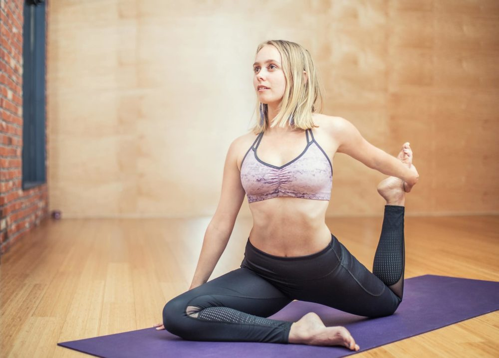 A picture of a woman doing yoga