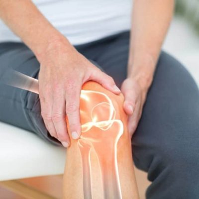 A guy holding his arthritic knee.
